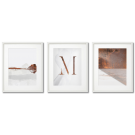 A copper letter M, a set of modern posters